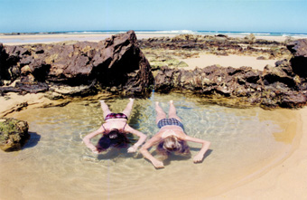Sandy Edwards, Marina and Laura in Lady Grounds Pool,<BR />Bithry's Inlet, Tanja, NSW, 1998&#8243;></p> <p class=