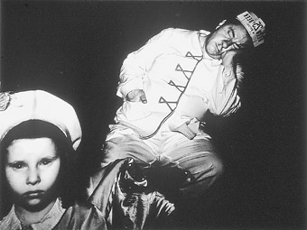 Weegee, At the movies - sleeping vendor (1940), silver gelatin photograph
