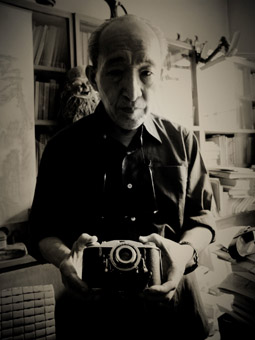 Wang Jingyao, husband of Bian Zhongyun, with the camera he used to photograph his wife's body in 1966 after she was murdered by Red Guards, in Hu Jie's documentary Though I Am Gone (2006)
