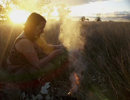 Lily Shearer leading a smoking ceremony at the posts