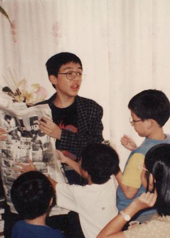 Family photograph of Teik-Kim Pok performing magic in Singapore circa 1995