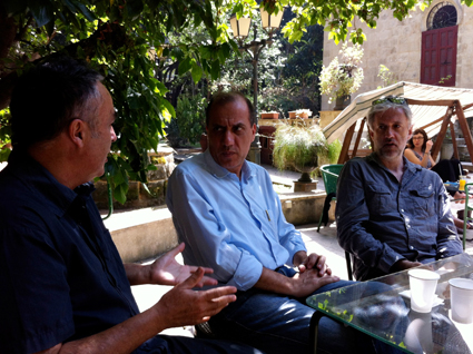 Jim Denley (left) discussing politics in Beirut with a local and musician Tony Buck