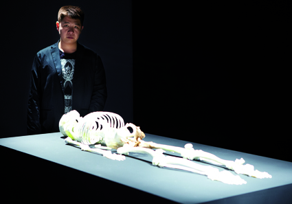 He Xiangyu alongside his work, Skeleton at 4A Centre for Contemporary Asian Art