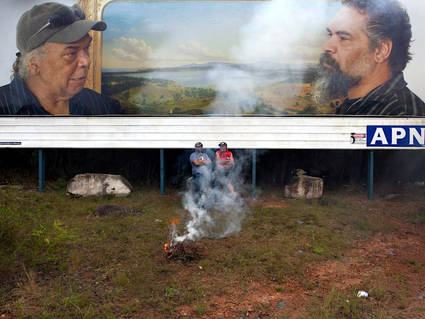 Roy takes a break after showing Kelton the best fishing spots (detail) with Roy Kennedy and Kelton Pell sitting at APN billboard site, Waterfall, NSW; Appropriated Circumstances, 2012