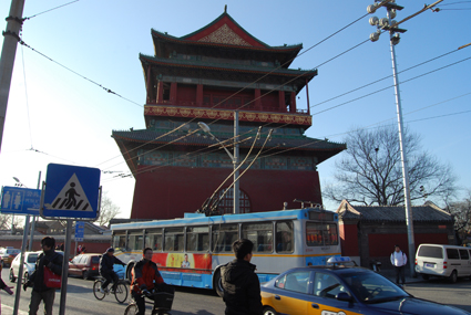 Cabs and electric buses work the streets of Beijing's old city centre in the shadow of Gu Lou (the Drum Tower)