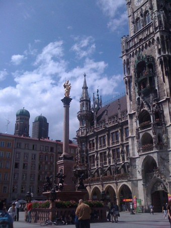 Munich's Rathaus (Old Town Hall) with the twin bell towers of the Frauenkirche in the distance