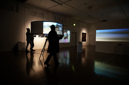 Volker Kuchelmeister, foreground Juxtaposition, 2010, Interactive video installation, background: A dromological vision machine, 2013, Interactive video installation
