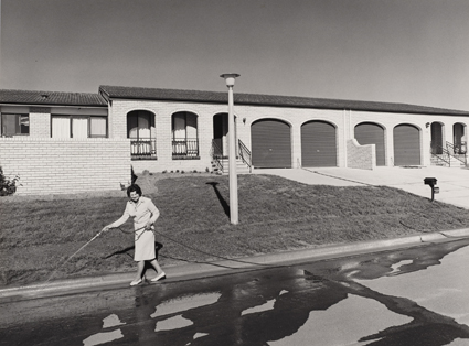 Gerrit Fokkema, Woman hosing, Canberra, 1979, in Australian Vernacular Photography,  courtesy Art Gallery of NSW