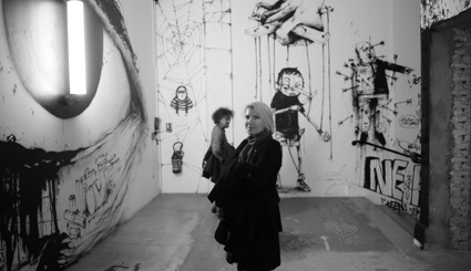 Gail Priest in front of artwork by Dran, part of the exhibition INSIDE, Palais de Tokyo, Paris, 20 Oct, 2014-10 Jan, 2015