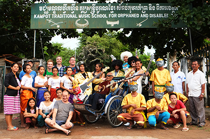 """Harley Stumm (back row 4th from L) with the team from """"Hanuman Spaceman"""" including The Cambodian Space Project, director Carlos Gomes, Master Kong Nay, and staff and students of Kampot Traditional Music School (Khmer Cultural Development Insti"""