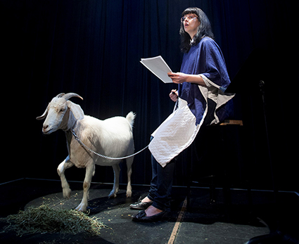 Emma Hall (and goat) in Sarah Rodigari's Reach Out Touch Faith (2014) which will be performed by Josephine Were in Near and Far