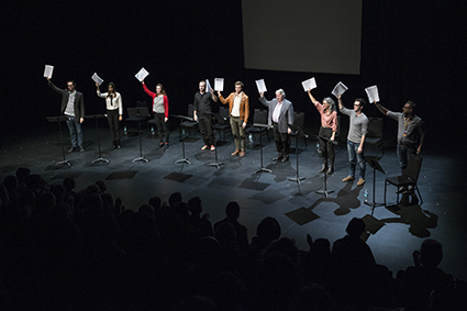 Actors 'take a bow' for the playwright by holding scripts aloft