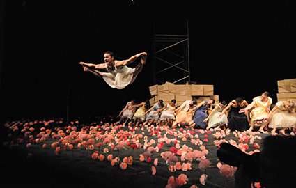 Paul White (foreground) and Tanztheater Wuppertal, Nelken (Carnations): a piece by Pina Bausch